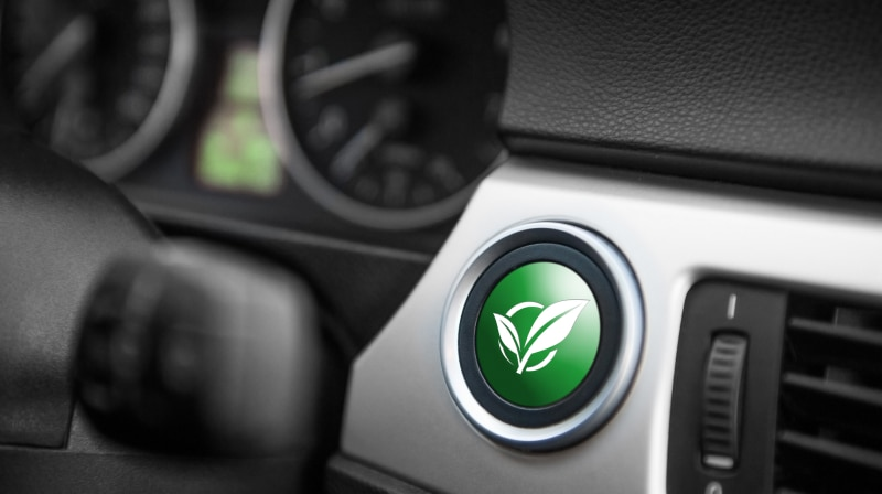 green efficiency button on dashboard of car